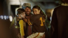 Brian Presley (center) plays a former high-school football star re-examining his life -- and, in this scene, carrying his daughters (Ella Anderson, left, and Jacquelyn Evola) in