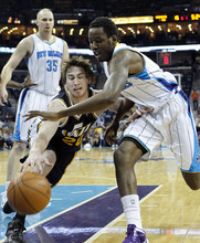 Utah Jazz shooting guard Gordon Hayward (20) battles for a loose ball with New Orleans Hornets small forward Al-Farouq Aminu (0) in the first half of an NBA basketball game in New Orleans, Friday, April 13, 2012. (AP Photo/Gerald Herbert)