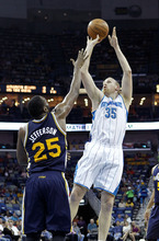 New Orleans Hornets center Chris Kaman (35) shoots over Utah Jazz center Al Jefferson (25) in the first half of an NBA basketball game in New Orleans, Friday, April 13, 2012. The Hornets won 96-85. (AP Photo/Gerald Herbert)