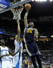 Utah Jazz center Al Jefferson (25) drives to the basket over New Orleans Hornets power forward Gustavo Ayon, center, and small forward Al-Farouq Aminu (0) in the first half of an NBA basketball game in New Orleans, Friday, April 13, 2012. (AP Photo/Gerald Herbert)