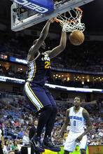 Utah Jazz center Al Jefferson (25) slam-dunks in front of New Orleans Hornets small forward Al-Farouq Aminu (0) in the first half of an NBA basketball game in New Orleans, Friday, April 13, 2012. (AP Photo/Gerald Herbert)