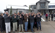 Al Hartmann  |  The Salt Lake Tribune Crowd and members of HGTV staff applalud as Vicki and William Naggy of Acme, PA, get a first look at their new $2 million dollar grand prize HGTV Dream Home in Midway on Friday, April 13.