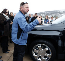 Al Hartmann  |  The Salt Lake Tribune Winner William Naggy kicks the tire and gives a thumbs up to the new Chevrolet SUV he and his wife won -- in addtion to the new $2 million dollar grand prize HGTV Dream Home in Midway.