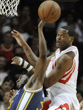 Utah Jazz's DeMarre Carroll, left, and Houston Rockets' Marcus Camby, right, compete for a rebound in the second half of an NBA basketball game Wednesday, April 11, 2012, in Houston. Utah won 103-91. (AP Photo/Pat Sullivan)