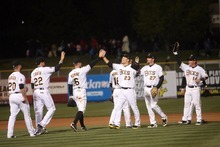 Kim Raff | The Salt Lake Tribune Bees players celebrate beating Tucson 5-4 during the Bees home opener against Tucson Padres at Spring Mobile Ballpark in Salt Lake City, Utah on April 13, 2012.