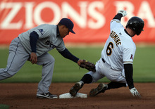 Kim Raff | The Salt Lake Tribune Bees player Andrew Romine safely slides into second before the tag from Tucson player Everth Cabrera during the Bees homeopener against Tucson Padres at Spring Mobile Ballpark in Salt Lake City, Utah on April 13, 2012.