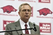 Arkansas athletic director Jeff Long discusses the firing of football coach Bobby Petrino, in Fayetteville, Ark., Tuesday, April 10, 2012. Long said that Petrino had engaged in reckless behavior that included hiring a mistress and then intentionally misleading his bosses. (AP Photo/April L. Brown)
