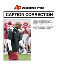 CORRECTS TO ARKANSAS DEFENSIVE COORDINATOR PAUL HAYNES, NOT ARKANSAS INTERIM HEAD COACH TAVER JOHNSON - Arkansas defensive coordinator Paul Haynes walks by as the team huddles before NCAA college football practice in Fayetteville, Ark., Friday, April 13, 2012. (AP Photo/April L. Brown)
