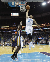 New Orleans Hornets shooting guard Eric Gordon (10) drives to the basket over Utah Jazz forward DeMarre Carroll (3) in the first half of an NBA basketball game in New Orleans, Friday, April 13, 2012. (AP Photo/Gerald Herbert)