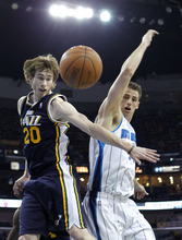 Utah Jazz shooting guard Gordon Hayward (20) and New Orleans Hornets power forward Jason Smith (14) battle for a loose ball in the first half of an NBA basketball game in New Orleans, Friday, April 13, 2012. (AP Photo/Gerald Herbert)