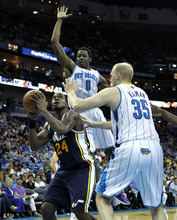 Utah Jazz power forward Paul Millsap (24) tries to shoot between New Orleans Hornets small forward Al-Farouq Aminu (0) and center Chris Kaman (35) in the second half of an NBA basketball game in New Orleans, Friday, April 13, 2012. The Hornets won 96-85. (AP Photo/Gerald Herbert)