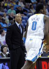 New Orleans Hornets head coach Monty Williams, left. calls out to his team in the first half of an NBA basketball game against the Utah Jazz in New Orleans, Friday, April 13, 2012. (AP Photo/Gerald Herbert)