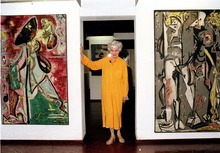 FILE - In this May 30, 1979, file photo, American art collector Peggy Guggenheim poses between early paintings by Jackson Pollock that are part of her modern art collection at her 18th century palace, Palazzo Venier dei Leoni, in Venice, Italy.  Pollock, who would have turned 100 in 2012, will have the anniversary of his birth observed with exhibitions, fundraisers and other events throughout the year.  (AP Photo/Jerry T. Mosey, File)