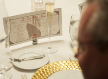 A menu is displayed during a re-creation of the final first class dinner served on the RMS Titanic, Saturday, April 14, 2012, in Houston. The Titanic sank in the North Atlantic Ocean April 15, 1912 after colliding with an iceberg during her maiden voyage from Southampton, England to New York. (AP Photo/Dave Einsel)