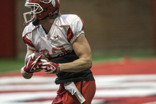 Chris Detrick     The Salt Lake Tribune Utah Utes wide receiver Sean Fitzgerald (83) runs the ball during a practice at the Spence Eccles Field House Thursday April 12, 2012.
