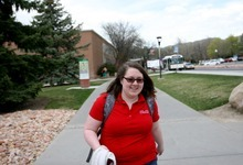 Kim Raff | The Salt Lake Tribune University of Utah senior Valerie Johnson walks to a Writing for Strategic Communications class on the U. campus in Salt Lake City, still in the shirt she wears for her job at the student union building. Administrators encourage students who work to find jobs on campus, because such students graduate faster than those working off-campus. Utah students graduate with less debt than in almost any other state.