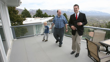 Steve Griffin | The Salt Lake Tribune   Dan Smuin, right, is graduating from the University of Utah with no debt. Smuin worked as a realtor and took eight years to complete his degree in human development and family studies. Here, he shows an Avenues home to Steve Hartvigsen and his son Joshua.