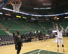 Rick Egan  | The Salt Lake Tribune   Derrick Favors warms up before the game agains the Dallas Mavericks, at he EnergySolutions Arena, Monday, April 16, 2012.