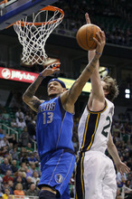 Dallas Mavericks guard Delonte West (13) attempts to score past Utah Jazz guard Gordon Hayward (20) during the first half of an NBA basketball game, Monday, April 16, 2012, in Salt Lake City. (AP Photo/Colin E Braley)