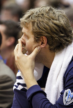 Dallas Mavericks forward Dirk Nowitzki rests on the bench during the first half of an NBA basketball game against the Utah Jazz, Monday, April 16, 2012, in Salt Lake City.  (AP Photo/Colin E Braley)