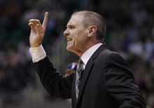 Dallas Mavericks coach Rick Carlisle yells out to his team during the first half of an NBA basketball game against the Utah Jazz, Monday, April 16, 2012, in Salt Lake City.  (AP Photo/Colin E Braley)