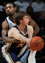 Memphis Grizzlies guard Tony Allen, left, defends Utah Jazz forward Gordon Hayward (20) in the second half of an NBA basketball game on Saturday, April 14, 2012, in Memphis, Tenn. The Grizzlies defeated the Jazz 103-98. (AP Photo/Nikki Boertman)