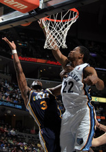 Memphis Grizzlies forward Rudy Gay (22) blocks a shot attempt by Utah Jazz forward DeMarre Carroll (3) in the first half of an NBA basketball game on Saturday, April 14, 2012, in Memphis, Tenn. (AP Photo/Nikki Boertman)