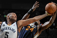 Memphis Grizzlies forward Marreese Speights battles Utah Jazz forward Paul Millsap (24) for a rebound in the second half of an NBA basketball game on Saturday, April 14, 2012, in Memphis, Tenn. The Grizzlies defeated the Jazz 103-98. (AP Photo/Nikki Boertman)