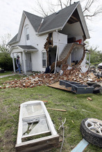 The home of Kenny Reeves in Thurman, Iowa is left severely damaged Sunday, April 15, 2012 after a tornado swept through the area Saturday evening. Fremont County Emergency Management Director Mike Crecelius said about 75 percent of the 250-person town was destroyed. (AP Photo/The Des Moines Register, Mary Chind)  NO SALES, NO MAGS, MANDATORY CREDIT