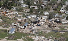 An aerial view of the destruction of the Oaklawn neighborhood in Wichita, Kansas, on Sunday, April 15, 2012. Residents of several states scoured through the wreckage of battered homes and businesses Sunday after dozens of tornadoes blitzed the Midwest and Plains Saturday night. (AP Photo/Jeff Tuttle)