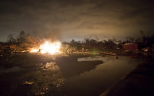 A fire burns in the Pinaire mobile home park in Wichita, Kansas after a tornado caused massive destruction in the area on Saturday night April 14, 2012. Tornadoes were spotted across the Midwest and Plains on Saturday as an outbreak of unusually strong weather seized the region, and forecasters sternly warned that