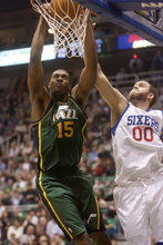 Jeremy Harmon  |  The Salt Lake Tribune  Derrick Favors dunks over Philadelphia's Spencer Hawes as the Jazz face the 76ers at EnergySolutions Arena on Friday, December 30, 2011.