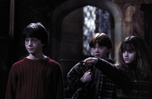 Harry and Ron watch as Hermione casts a spell in