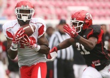 Leah Hogsten  |  The Salt Lake Tribune Utes wide receiver DeVonte Christopher grabs the catch and pushes past Tyler White. University of Utah football team held their Spring red and white scrimmage Saturday, April 14 2012 in Salt Lake City at Rice Eccles Stadium.
