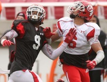 Leah Hogsten  |  The Salt Lake Tribune Utes wide receiver Dres Anderson pulls down the pass before defensive back Lewis Walker. University of Utah football team held their Spring red and white scrimmage Saturday, April 14 2012 in Salt Lake City at Rice Eccles Stadium.