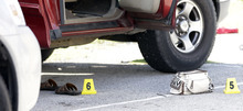 A purse and sandals lie next to the truck of a mother who was killed and her baby kidnapped, Tuesday, April 17, 2012, in Spring, Texas.  A newborn boy was abducted from his screaming mother after she was repeatedly shot outside a suburban Houston pediatric center on Tuesday, according to investigators searching for the suspected shooter who sped off with the infant in a blood-stained Lexus. (AP Photo/David J. Phillip) (AP Photo/David J. Phillip)