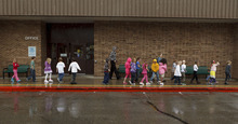 Trent Nelson  |  The Salt Lake Tribune First graders at Granite Elementary evacuate the school during a statewide earthquake drill Tuesday, April 17, 2012 in Sandy, Utah.
