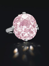 In this undated photo provided by Christie's Auction House in New York, a rare pink cushion-cut 9-carat diamond ring from the estate of the late copper heiress Huguette Clark is shown. The piece, believed to be owned by Clark's mother, sold for $15,762,500 at Christies' New York Magnificent Jewels auction on Tuesday, April 17, 2012. (AP Photo/Christie's Auction House)
