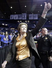 FILE - In this March 19, 2012, file photo, Tennessee head coach Pat Summitt gives a thumbs-up as she leaves the court after Tennessee defeated DePaul 63-48 in an NCAA tournament second-round women's college basketball game in Rosemont, Ill. Summitt, the sport's winningest coach, is stepping aside as Tennessee's women's basketball coach and taking the title of