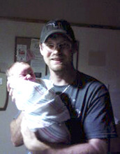 This photo provided by Dean Burrell shows Keith Schuchardt holding his newborn son, Keegan, in The Woodlands, Texas. The 3-day old baby was abducted from his wife, Kala Golden Schuchardt, in the parking lot of a medical clinic on Tuesday, April 17, 2012 in Spring, Texas. Kala was shot by the abductor and later died at the hospital. The baby was recovered later Tuesday and a suspect has been charged in the shooting and kidnapping. (AP Photo/Courtesy of Dean Burrell)