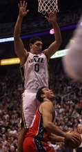 Kim Raff |The Salt Lake Tribune Utah Jazz player Enes Kanter defends New Jersey Nets player Kris Humphries under the basket during the second half at Energy Solutions Arena in Salt Lake City, Utah on January 14, 2012.    The Jazz went on to win 107-94.
