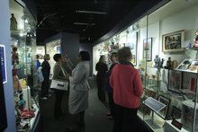 In a March 14, 2012 photo, visitors look over displays at the Jim Crow Museum of Racist Memorabilia in Big Rapids, Mich. The museum says it has amassed the nation's largest public collection of artifacts spanning the segregation era, from Reconstruction until the civil rights movement, and beyond. (AP Photo/Carlos Osorio)