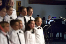 Paul Fraughton | The Salt Lake Tribune. The Clearfield Children's Choir performs at  the Community Choir's Spring concert at The Clearfield Community Church.Clearfield's mayor, Don Wood plays the piano for the performers.  Monday, April 16, 2012