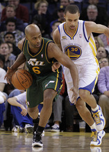 Utah Jazz guard Jamaal Tinsley (6) drives against Golden State Warriors' Stephen Curry (30) during the first half of an NBA basketball game on Thursday, Feb. 2, 2012, in Oakland, Calif. (AP Photo/Ben Margot)