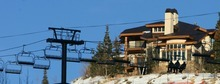 Steve Griffin  |  The Salt Lake Tribune   Skiers ride a ski lift that passes in front of a large home at Deer Valley Resort in Park City, Utah Tuesday, December 20, 2011.
