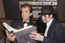 FILE - In this Jan. 24, 1993 file photo, singer Michael Jackson and American Music Awards executive producer Dick Clark go over the script during rehearsals for The American Music Awards at the Shrine Auditorium in Los Angeles. Clark, the television host who helped bring rock `n' roll into the mainstream on
