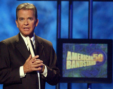 FILE - In this April 20, 2002 file photo, Dick Clark, host of the American Bandstand television show, introduces entertainer Michael Jackson on stage during taping of the show's 50th anniversary special in Pasadena, Calif. Clark, the television host who helped bring rock `n' roll into the mainstream on