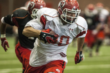 Chris Detrick  |  The Salt Lake Tribune Utah Utes tight end Westlee Tonga (80) runs the ball during a practice at the Spence Eccles Field House Thursday April 12, 2012.