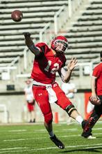 Chris Detrick  |  The Salt Lake Tribune Utah Utes quarterback Adam Schulz (12) throws the ball during a practice at Rice-Eccles Stadium Tuesday April 17, 2012.