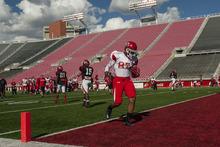 Chris Detrick  |  The Salt Lake Tribune Utah Utes wide receiver Quinton Pedroza (87) runs for a touchdown during a practice at Rice-Eccles Stadium Tuesday April 17, 2012.